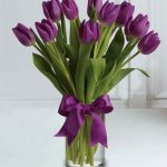 purple tulip flowers with vase